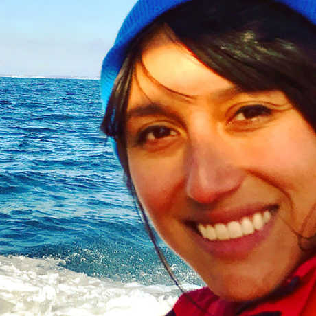 Vicky Vasquez in front of waves