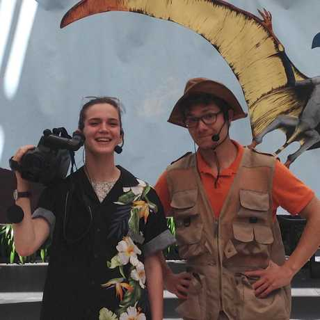 a director and paleontologist character in front of a pterosaur backdrop