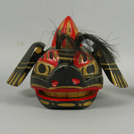 A mingei dog folk toy.