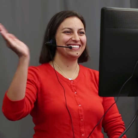 An Academy educator leads a distance learning class in front of a webcam