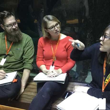 teachers reflecting in the aquarium