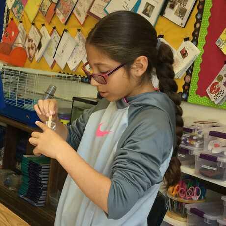 girl doing science