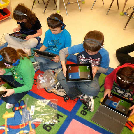 Students playing tablet game