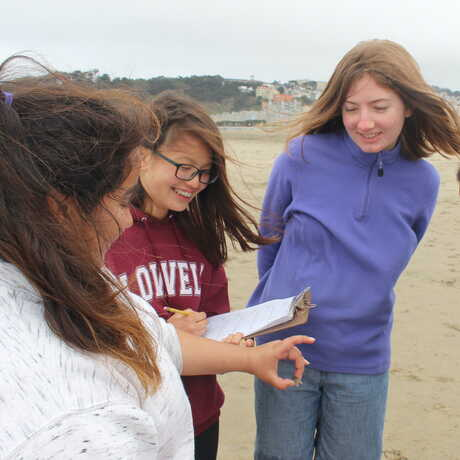 Students explore nature and engage with citizen science during an outdoor bioblitz.