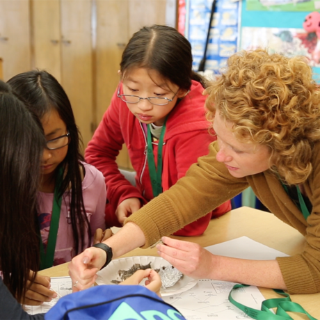 Teacher working with students on STEM