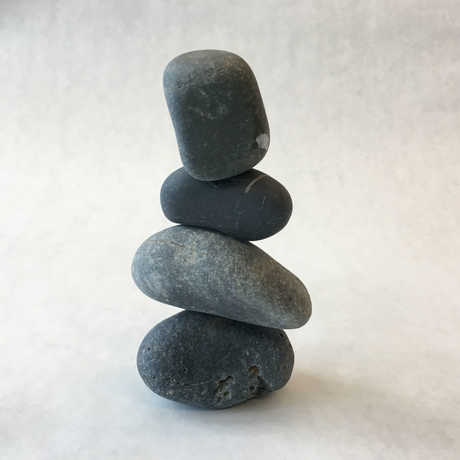 a cairn of four rocks on top on one another