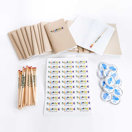 Science Action Club Cloud Quest notebooks and supplies against white background