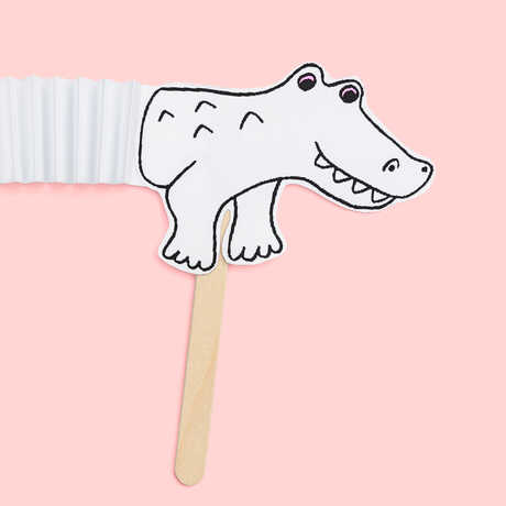 Cute alligator craft with accordion-like middle section against pink background
