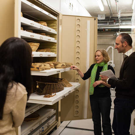 People on a guided tour looking at Anthropology specimens