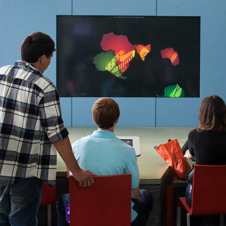"Visitors play the interactive ""Connect the Continents"" game"