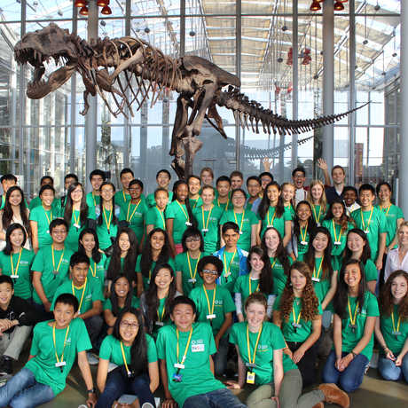 Our TASC volunteers in front of the T. rex skeleton in the California Academy of Sciences.