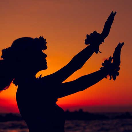 The sun sets on a Polynesian dancer