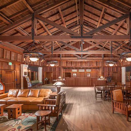 The rich wood interior of Asilomar's social hall