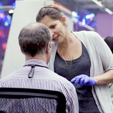 Michelle Trautwein sampling face mites from a volunteer ©Lauren Nichols