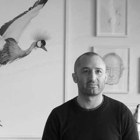 Black-and-white portrait of photographer Andrew Zuckerman