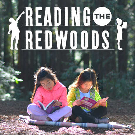 2 girls reading in a redwood grove