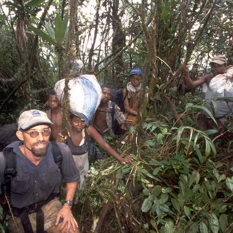 Fisher treks through the jungle with local guides