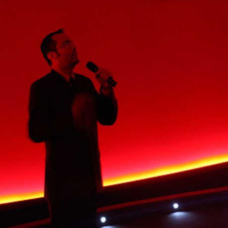 Ryan Wyatt speaking to a planetarium full of guests