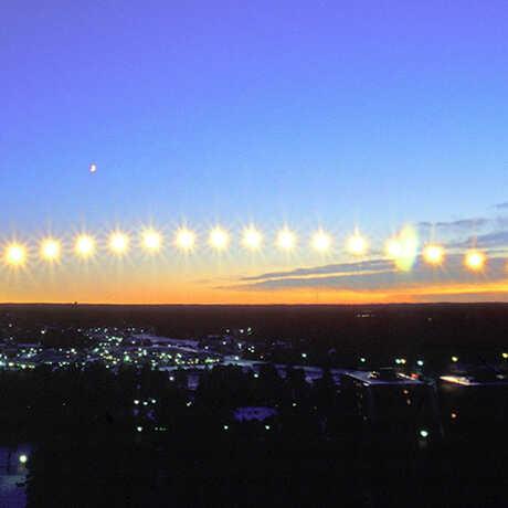 Time-lapse photo of sun moving across horizon