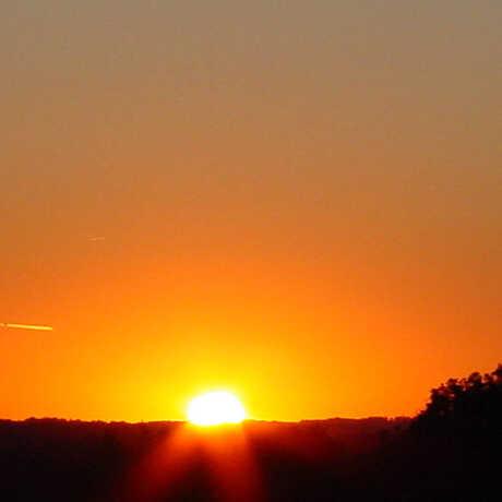 Sun setting on horizon during equinox