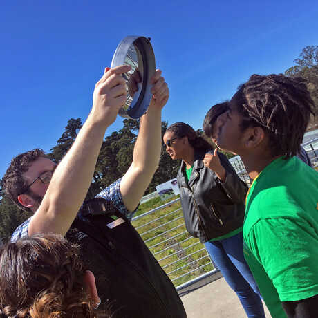 Academy educator demonstrates how telescopes work to students