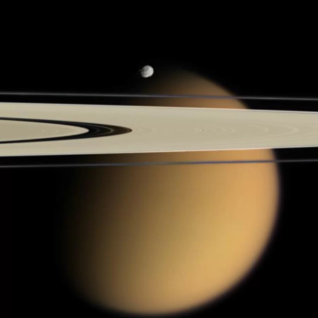 Titan with foreground Rings and minor moon of Saturn