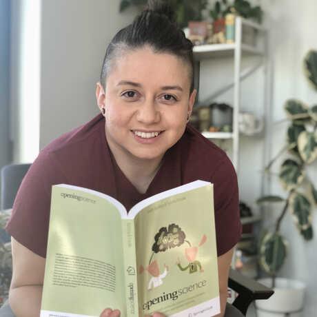 Monica Granados holding a book