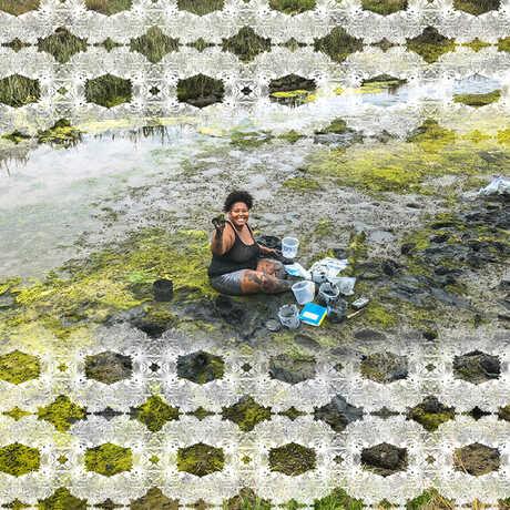 Tiara Moore sitting in a marsh