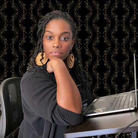 Nicole Jackson sitting at her computer