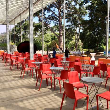 East Garden terrace with red chair setup