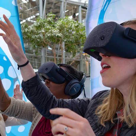 3 women wearing virtual reality headsets