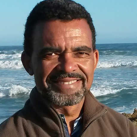 Dr. David Obura in front of waves