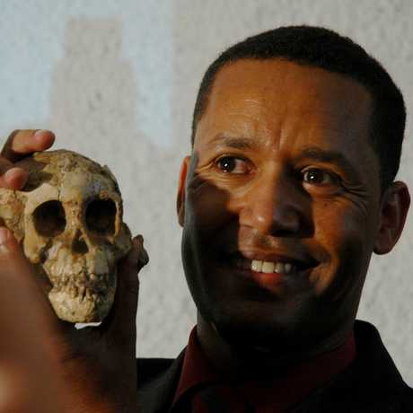 "Dr. Zeresenay ""Zeray"" Alemseged holding Selam skull"