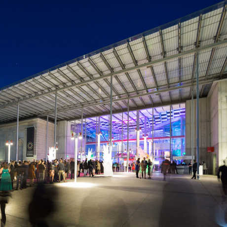 The main entrance of the Academy at night with line of people
