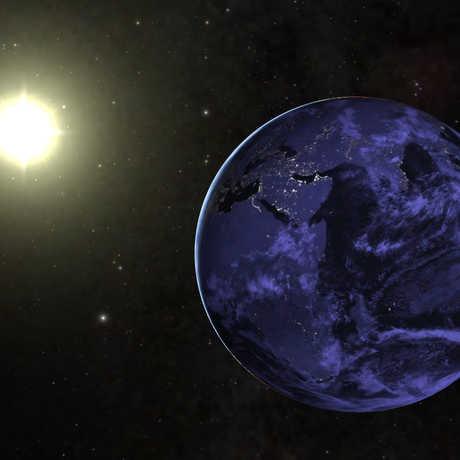 The Earth orbiting the Sun.