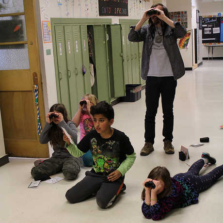 SAC members using binoculars
