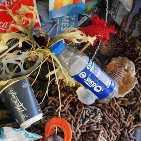 Trash piled up after a beach clean-up.