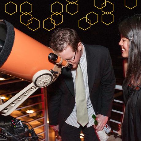 Hive members look through a telescope