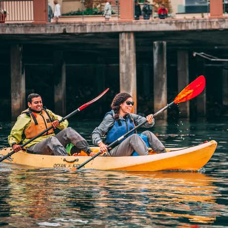 Couple kayaking in Monterey Bay
