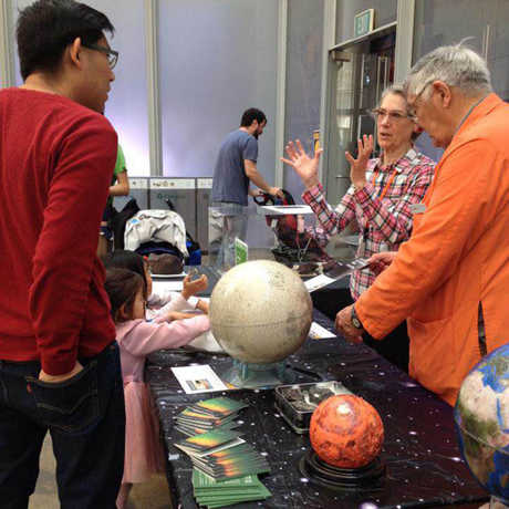 Academy Docents answer astronomy questions from visitors.