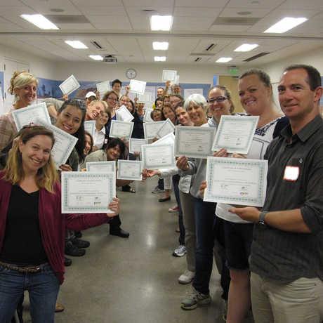 Teachers earning certificates