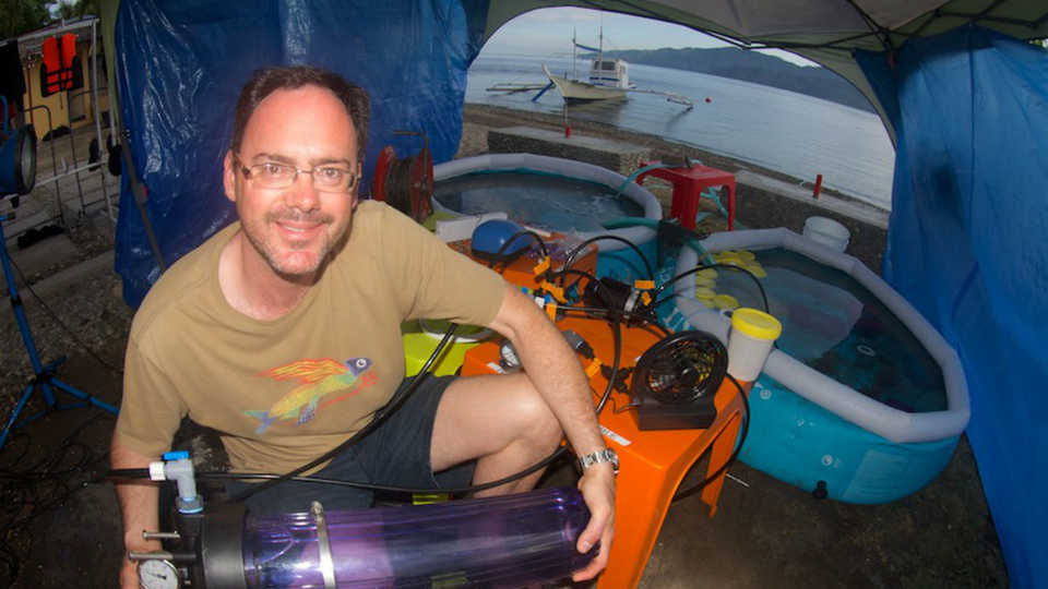 Bart Shepherd holds a hyperbolic chamber for fish in the Philippines