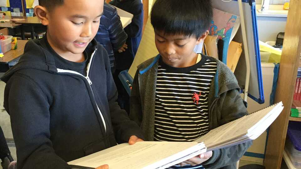 students sharing notebooks