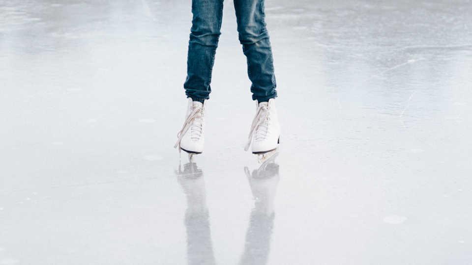 ice skater on ice rink