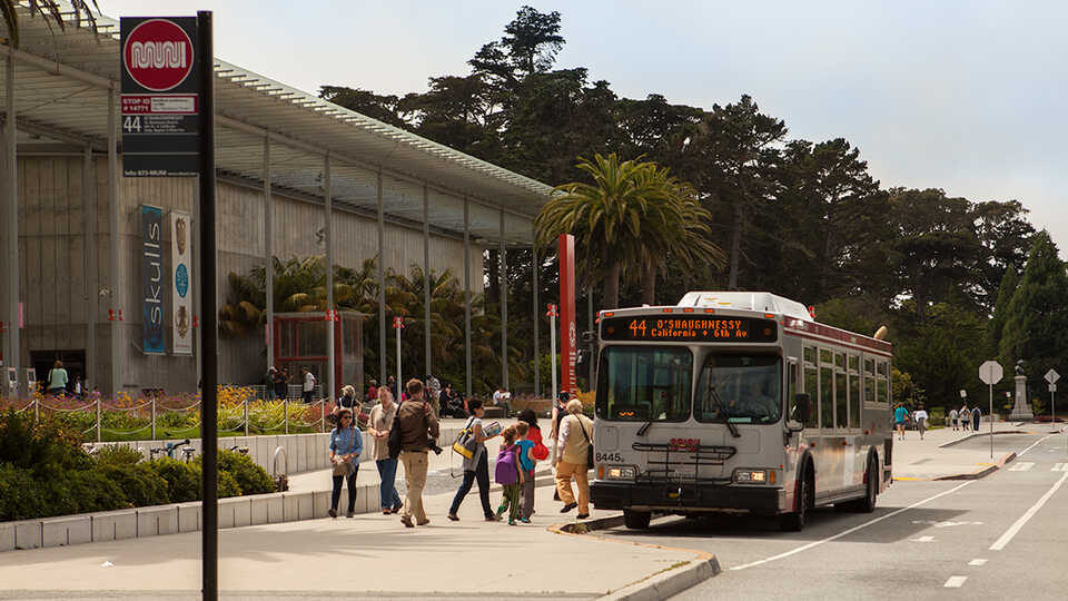 Muni bus 44 in front of the California Academy of Sciences building.